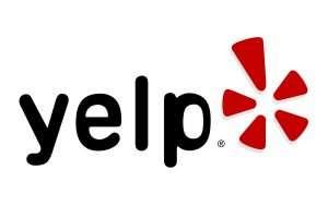 """logo reads """"yelp"""""""