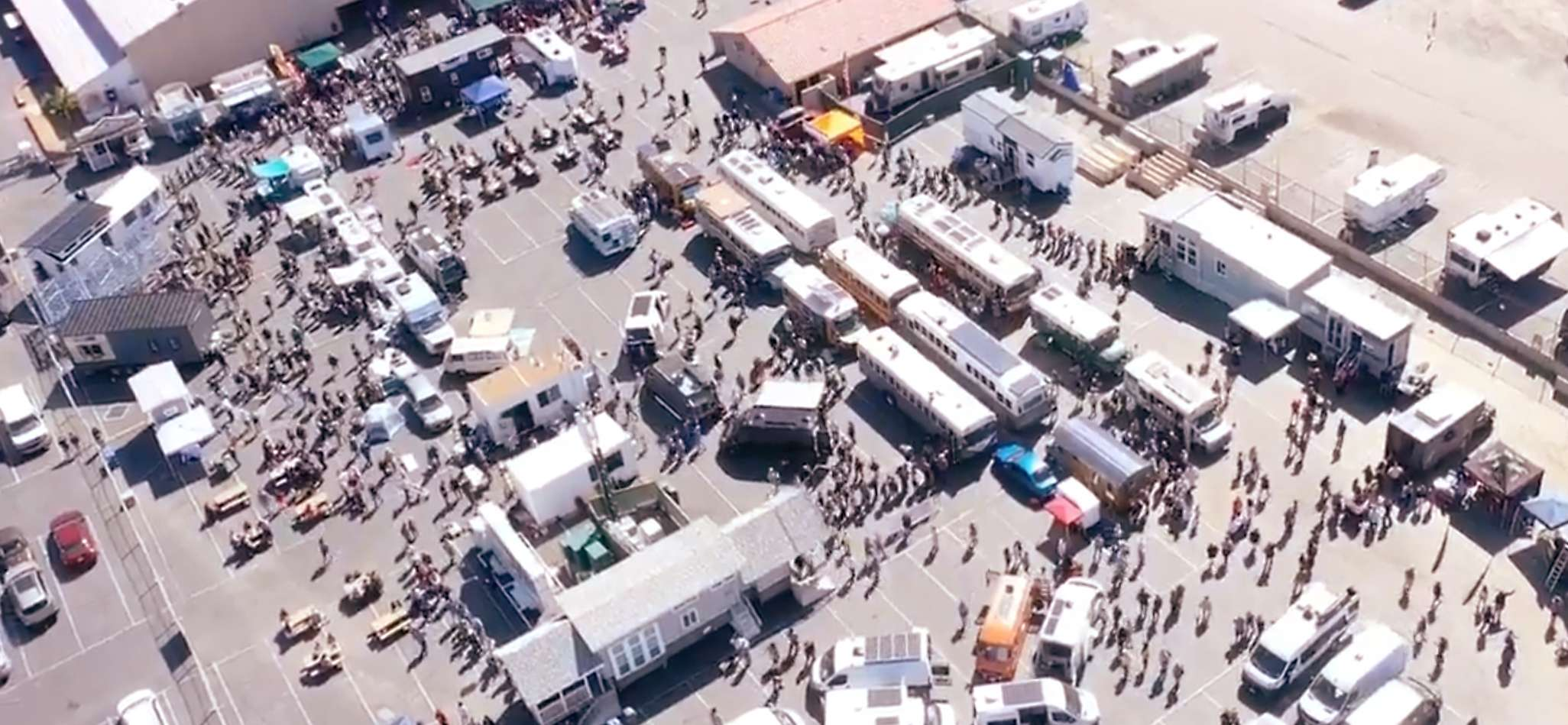 aerial view of an exhibit of tiny houses, vans & school buses