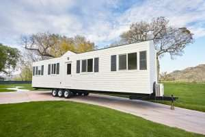 a 40ft long tiny house on wheels. It's long and lean, all white with black trim