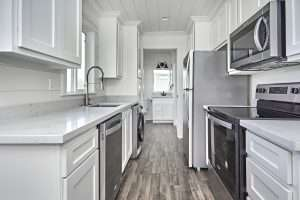 inside of a tiny house house all white with black appliances