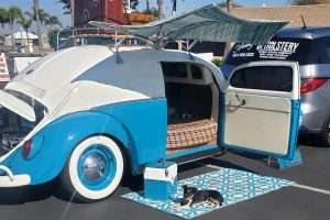 blue and white VW bug turned into a teardrop camper