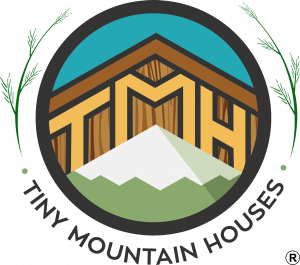 logo reads Tiny Mountain Houses and has a graphic with a mountain and the roofline of a house above it. in between the two are the initials TMH