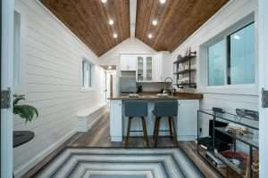 interior image of a tiny house. white walls, wood ceiling, clean look