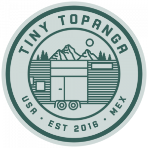 logo reads Tiny Topanga USA Est. 2016 MEX around the outside in a circle. Inside the circle is a sketch of a tiny house with mountains in the background