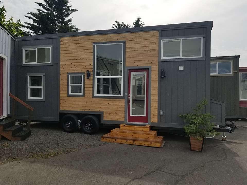 tiny house on wheels exterior photo gray and wood siding