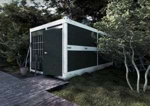 green shipping container that has been painted green