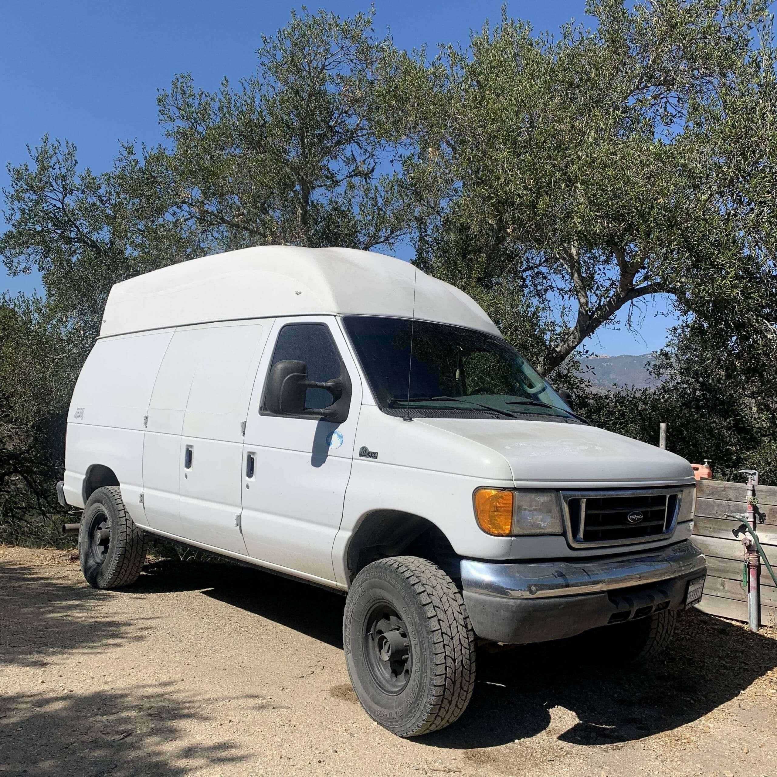 white van with raised top and big wheels